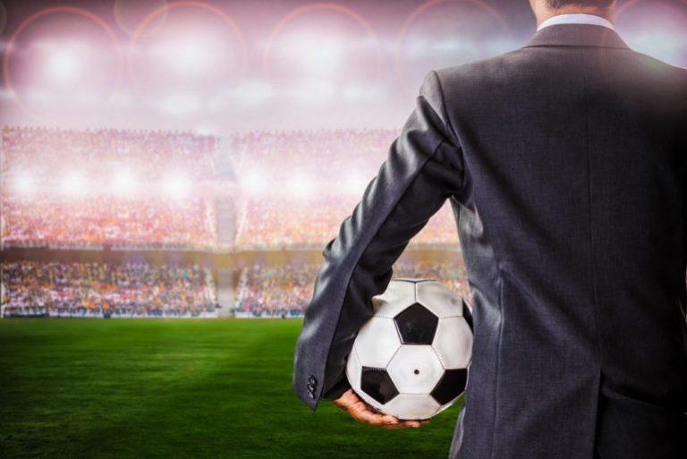 Imagem ilustrativa de executivos de futebol